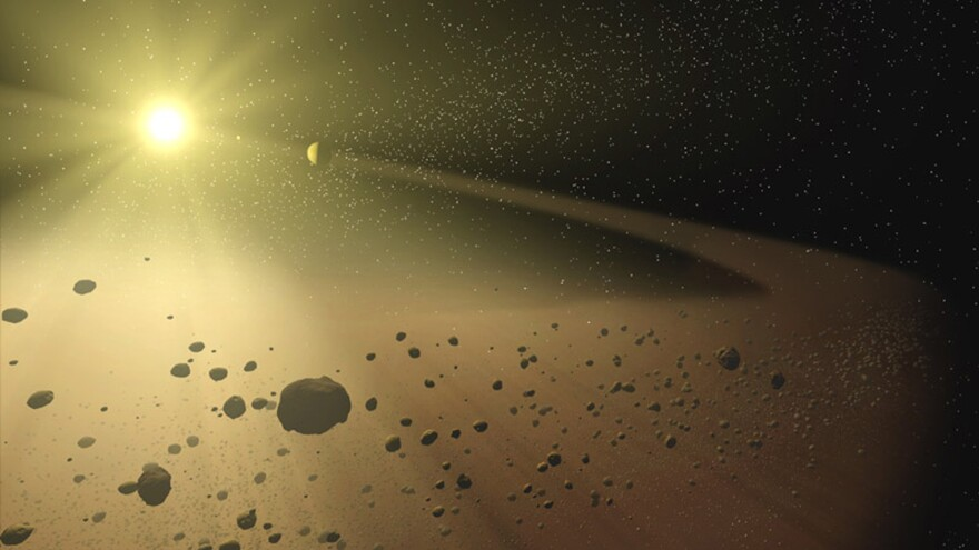 An artist's concept of a narrow asteroid belt orbiting a star similar to our own sun.