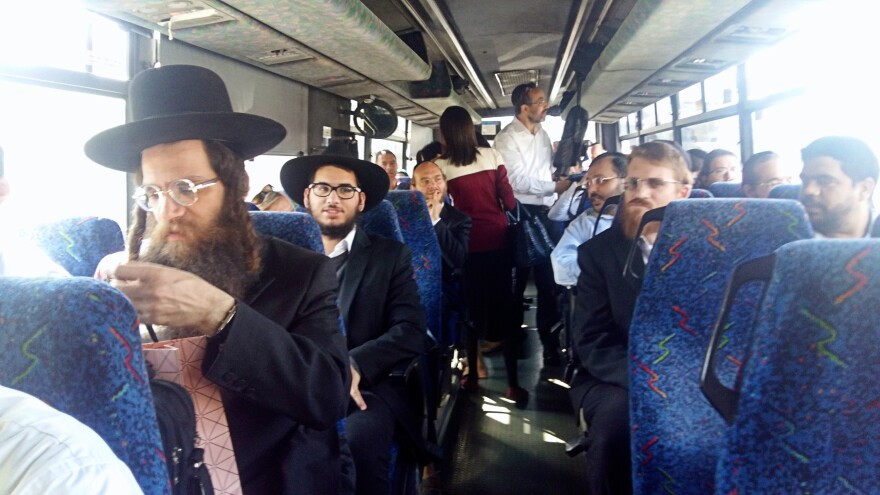 Ultra-Orthodox Jews, many of whom live in closed religious communities, on a bus tour of the Israeli offices of Google, Facebook and Microsoft. The tour is sponsored by KamaTech, a group that helps integrate the ultra-Orthodox into Israel's high-tech sector.