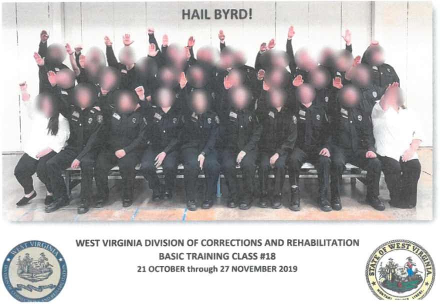 "The photo, which was included in graduation packets, carries the state seal and the official symbol of the Division of Corrections and Rehabilitation. It's captioned ""Hail Byrd"" in a reference to instructor Karrie Byrd. She was responsible for Class #18 teaching cultural diversity."