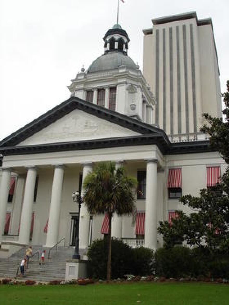 Florida's Old State Capitol building is shown in the foreground with the current State Capitol in the background in Tallahassee.