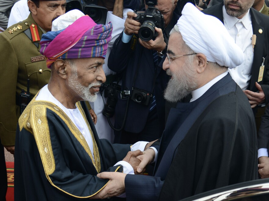 Oman's Sultan Qaboos (left) greets Iranian President Hassan Rouhani in Muscat in February 2017.
