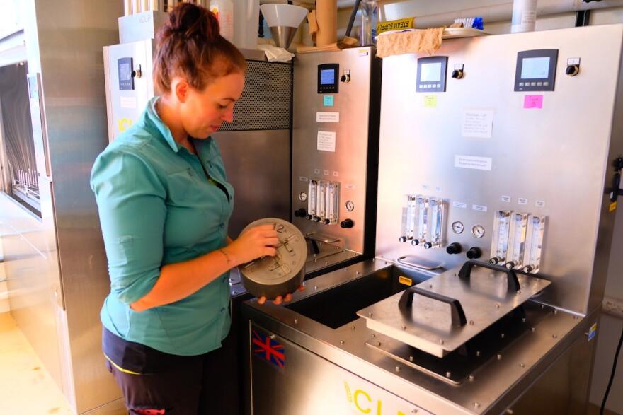 Hannah Turner showing the malting lab MSU