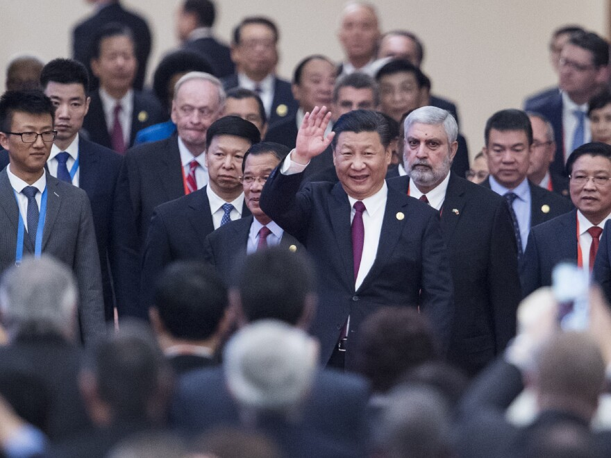 China's President Xi Jinping arrives with visiting leaders at a meeting held by the Communist Party of China in Beijing Dec. 1.