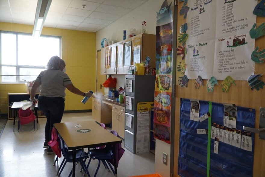 Fort Worth ISD employee Yolanda Cintron assists with a deep cleaning at the Leadership Academy at John T. White Elementary School in Fort Worth, Texas on Thursday, March 12, 2020.