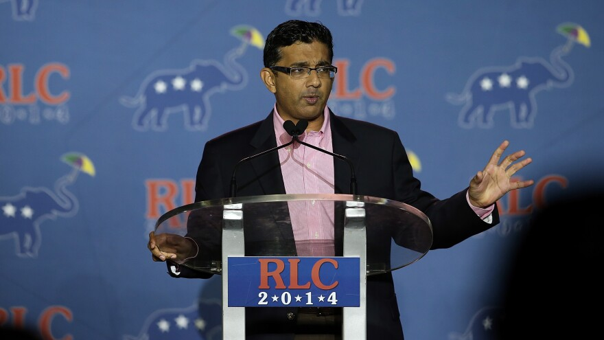 Conservative filmmaker and author Dinesh D'Souza speaks during the final day of the 2014 Republican Leadership Conference on May 31 of that year in New Orleans. Earlier that month, he had pleaded guilty to campaign finance fraud.
