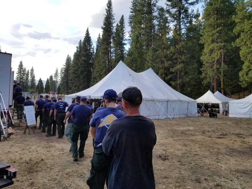Firefighters in line for dinner at a fire camp.