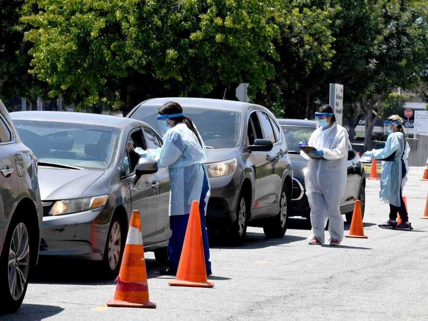 Drivers line up for COVID-19 testing in the Sherman Oaks neighborhood of Los Angeles in May.