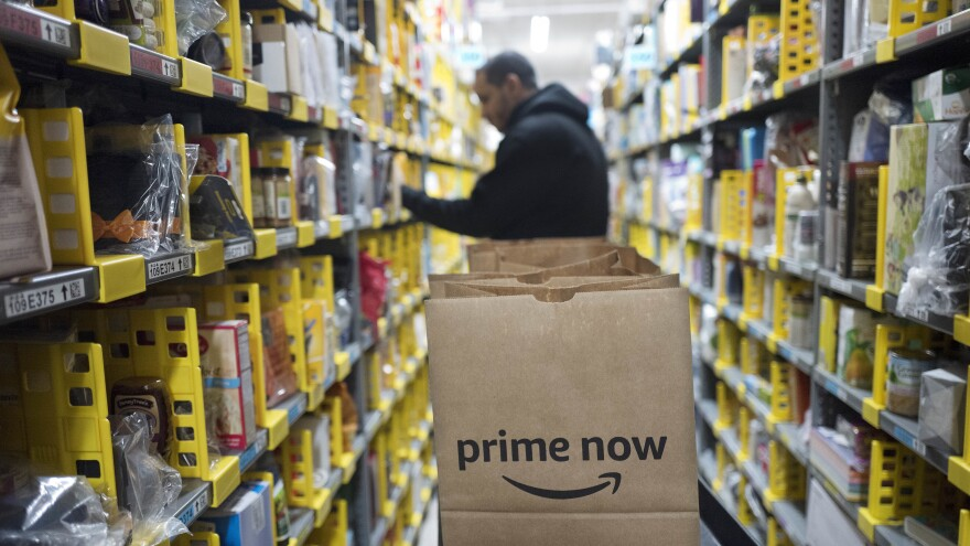 "A clerk pick an item for a customer order at the Amazon Prime warehouse in New York. <em>Amazon Empire</em> director James Jacoby describes the pace of work within the company's warehouses as ""incredibly grueling."""