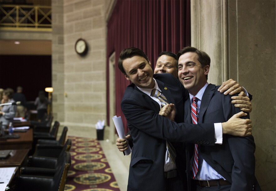 After noticing a photographer taking pictures of them talking, State Representatives J.J. Rizzo, D-Kansas City, Jake Hummel, D-St. Louis, and Jay Barnes, R-Jefferson City, joke with each other while posing for a picture.