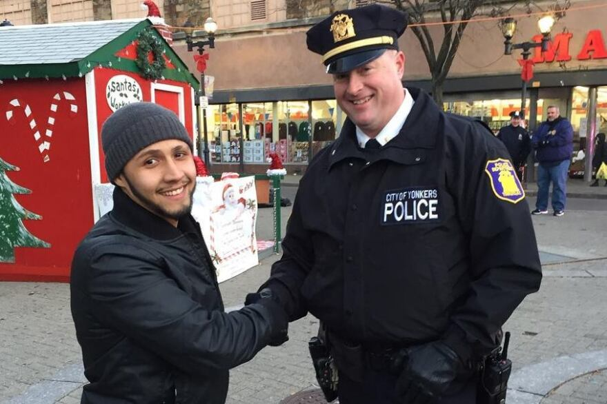 """Yonkers community activist Hector Santiago demonstrates the """"stop-and-shake"""" with Lt. Pat McCormack of the Yonkers Police Department. The idea, Santiago says, is to get people to introduce themselves to cops on the street."""