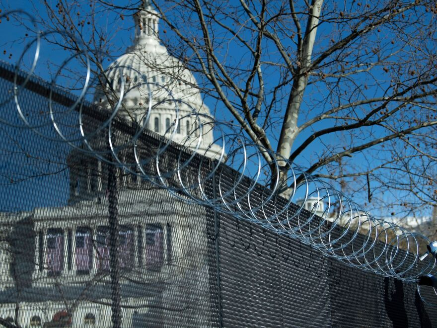 Enhanced security measures, including razor wire atop a security fence surrounding the U.S. Capitol, are being implemented across the nation in preparation for next week's Presidential inauguration.