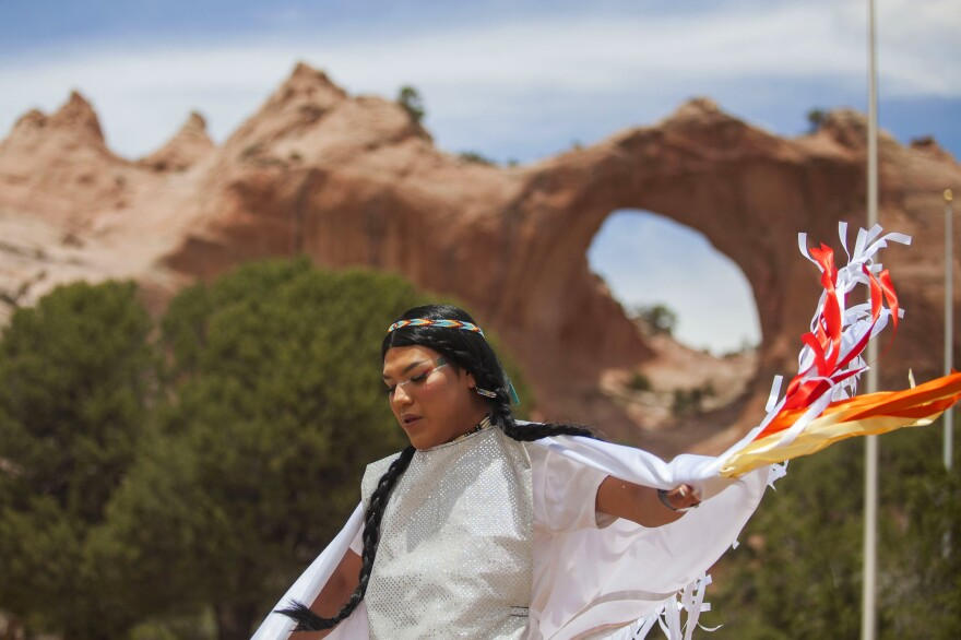 Geronimo Louie dances in a rainbow-themed shawl in front of the Window Rock park at Diné Pride. Half Navajo and half Apache, Louie spoke about the experience coming out as gay within those two cultures.