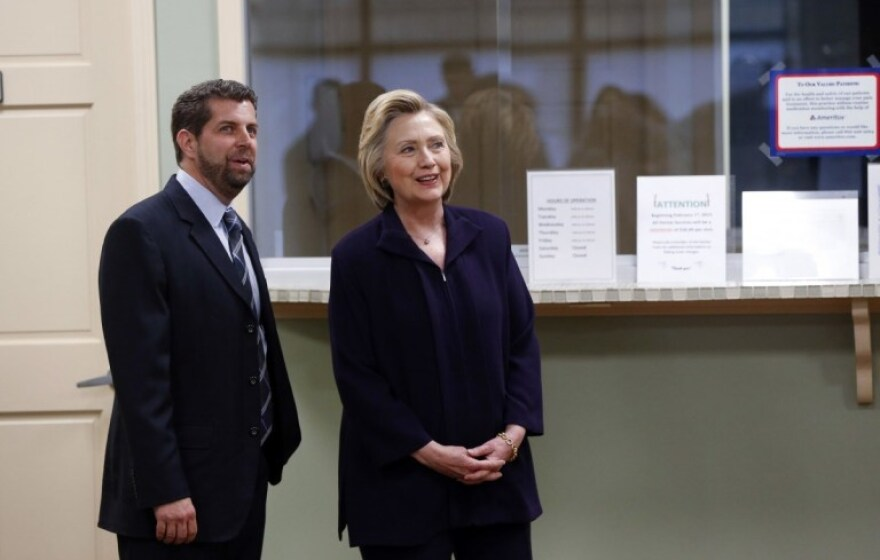 "Dr. Christopher ""Dino"" Beckett, CEO of Williamson Health and Wellness Center, left, walks with Democratic presidential candidate Hillary Clinton during a tour of the facility in Williamson, W.V., in May 2016."