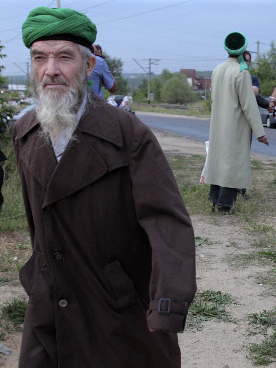 """Self-proclaimed """"messenger of God"""" Faizrakhman Satarov approaches the Kazan house earlier this month. The sect's founder says he had a revelation from God that true Muslims must separate themselves from society."""