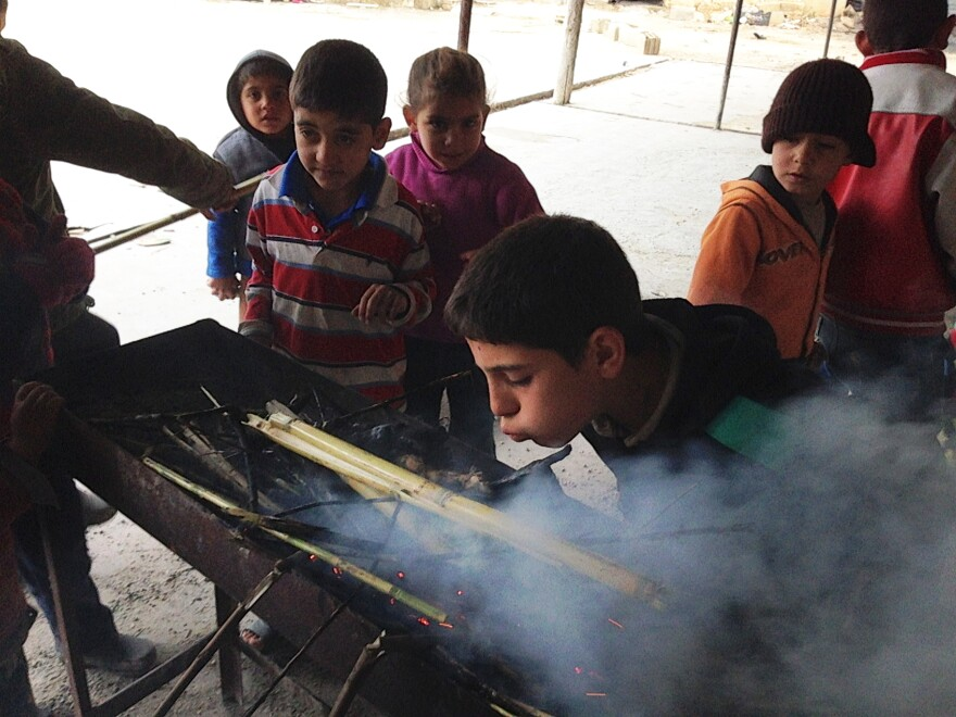 Syrian refugee children at the camp near Saida try to make a fire to keep warm, but the damp brush produces more smoke than heat. Most have no access to school and are forced to spend their days in the camp.