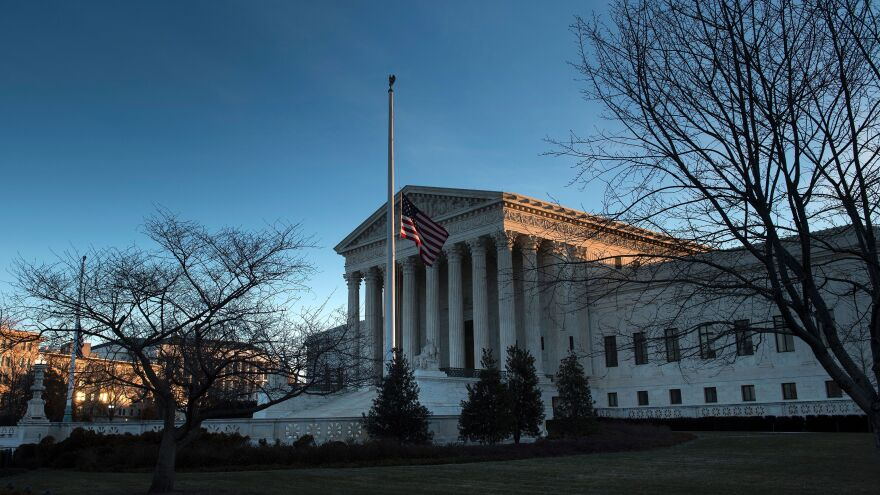 An American flag flies at half-staff outside the U.S. Supreme Court after the death of Justice Antonin Scalia. The fight to replace him could be historic, resulting in the longest vacancy in history.