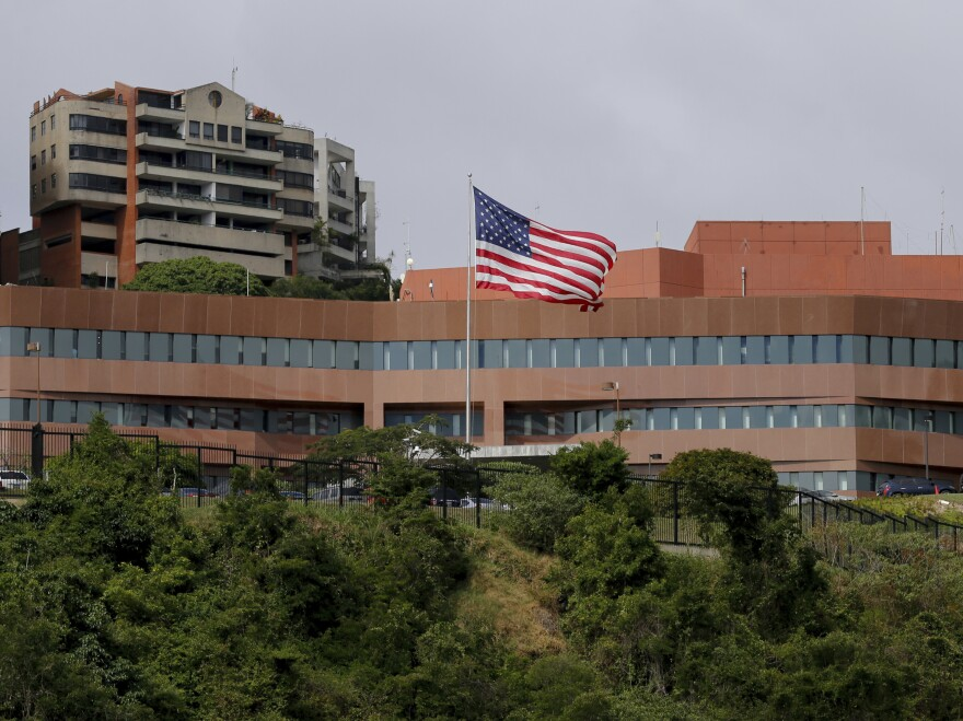 A U.S. flag flies outside the U.S. Embassy in Caracas, Venezuela, in January. Secretary of State Mike Pompeo announced that all remaining embassy personnel would be withdrawn this week.