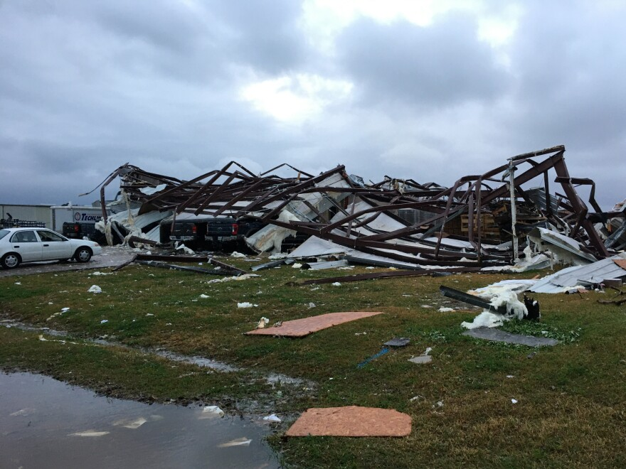 The remains of a tornado-damaged building in Alexandria, La., on Monday, after storms went through the Deep South and killed three people.