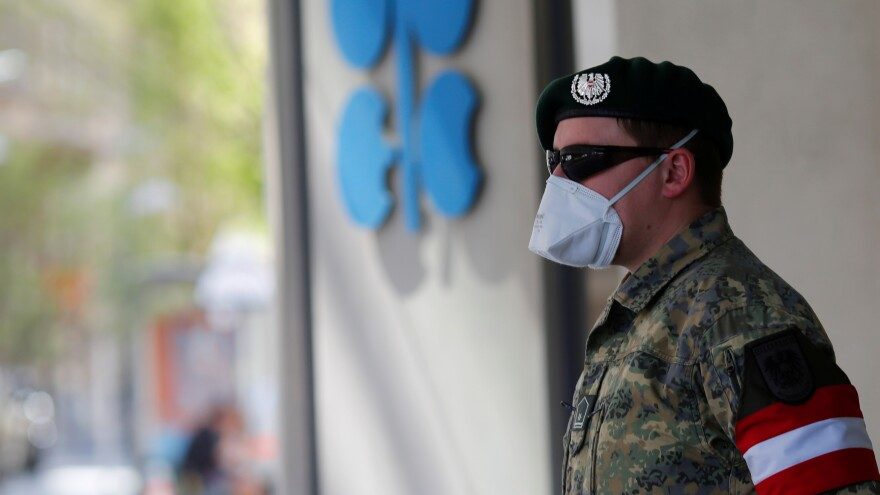 An Austrian army member stands in front of OPEC's headquarters in Vienna on Thursday.