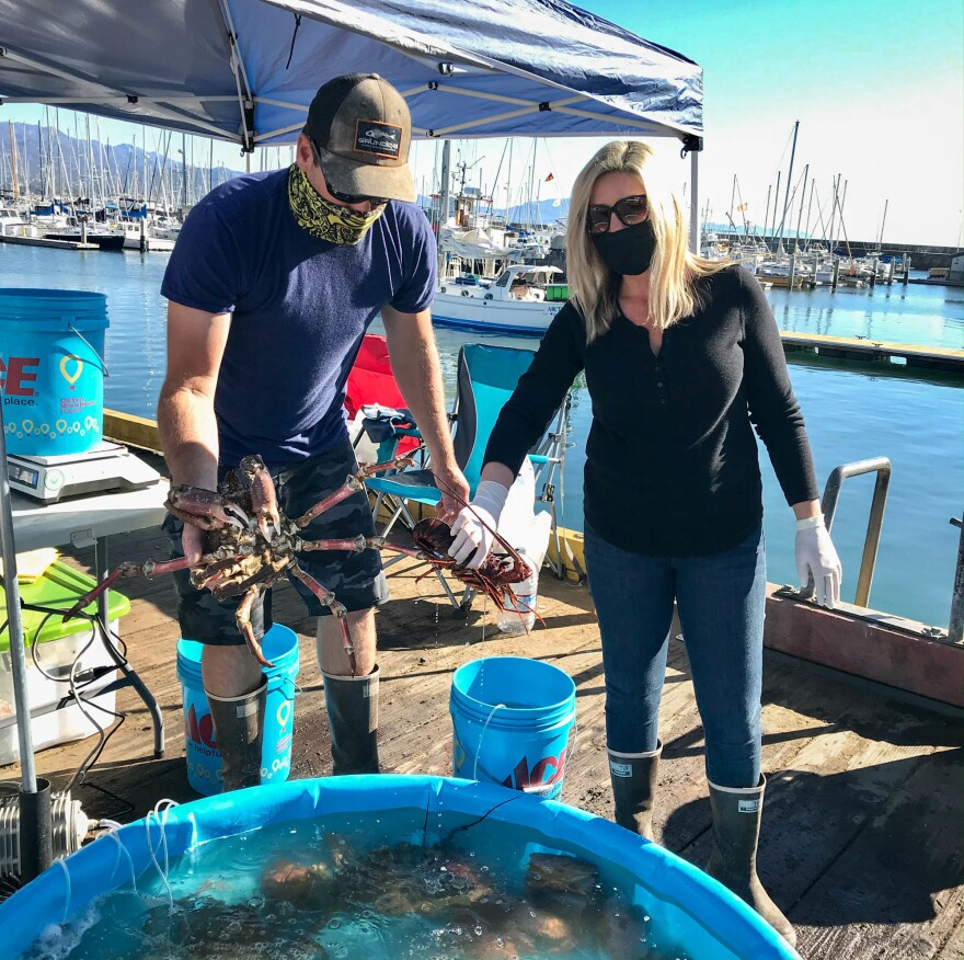 Joseph and Melissa Garrigan of Garrigan Seafood Co. show off a freshly caught spider crab and a California spiny lobster.