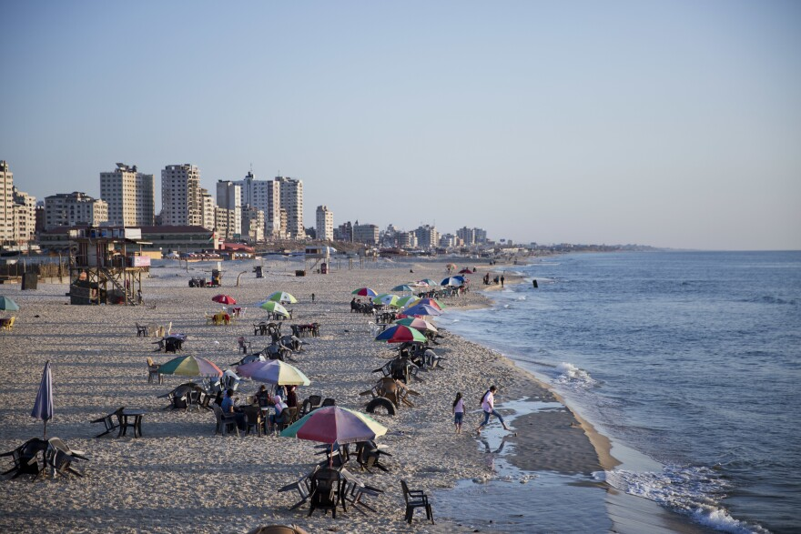 Families and friends enjoy their time on a Gaza City beach. Israel allows in international aid workers, journalists and diplomats, but tourists are prohibited.