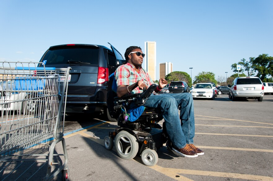 Nnaka runs an errand at a local Wal-Mart before heading home in Tulsa. Before he got his own van, Nnaka had to rely on a special lift service provided by the city to get around.