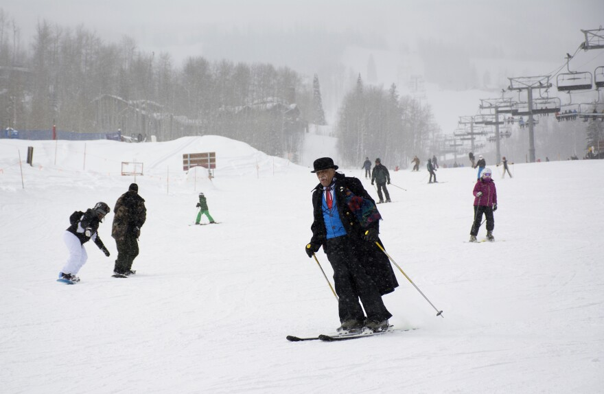 Art Clay, 78, of Chicago takes a run in a light snowfall on Wednesday. Clay is a co-founder of the National Brotherhood of Skiers.