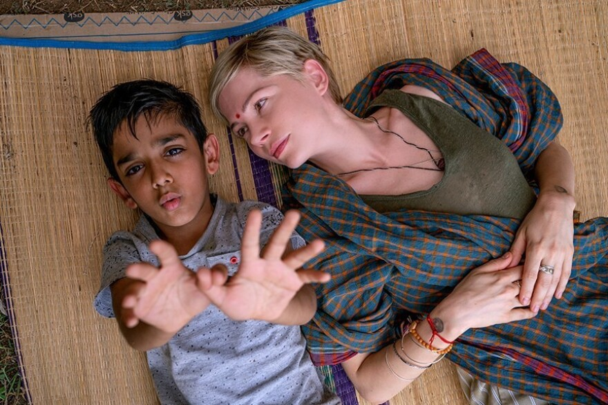 In <em>After the Wedding</em>, Michelle Williams plays Isabel, who runs an orphanage in India. Vir Pachisia plays Jai, the boy beside her.