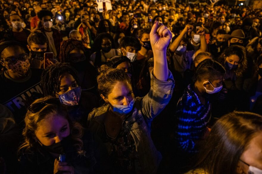 Thousands gather in Black Lives Matter Plaza near the White House to watch President-elect Joe Biden and Vice President-elect Kamala Harris speak from Delaware in Washington, DC.