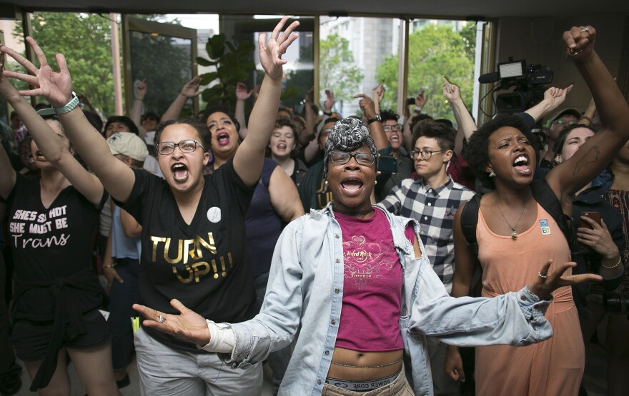 Krys Didtrey, left, and Gloria Merriweather, center, led chants in a Raleigh, N.C., statehouse protest in 2016 in opposition to HB2, a state law that, in effect, required people to only use designated bathrooms that matched the sex on their birth certificate. The law was repealed in 2017.