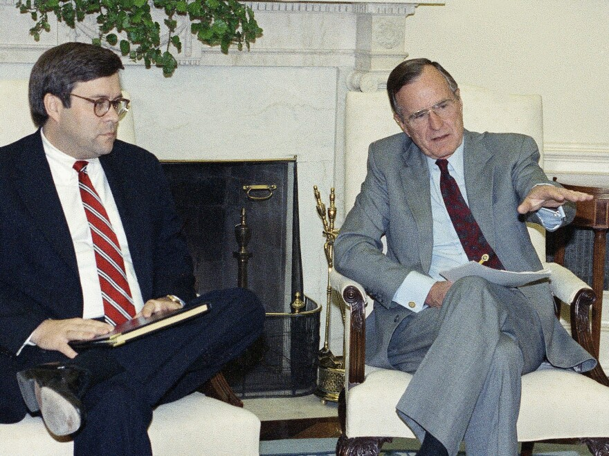 Then-Attorney General William Barr, left, with President George H.W. Bush. Barr supported Bush's pardons for six people caught up in the Iran-Contra scandal, which is resonating today.
