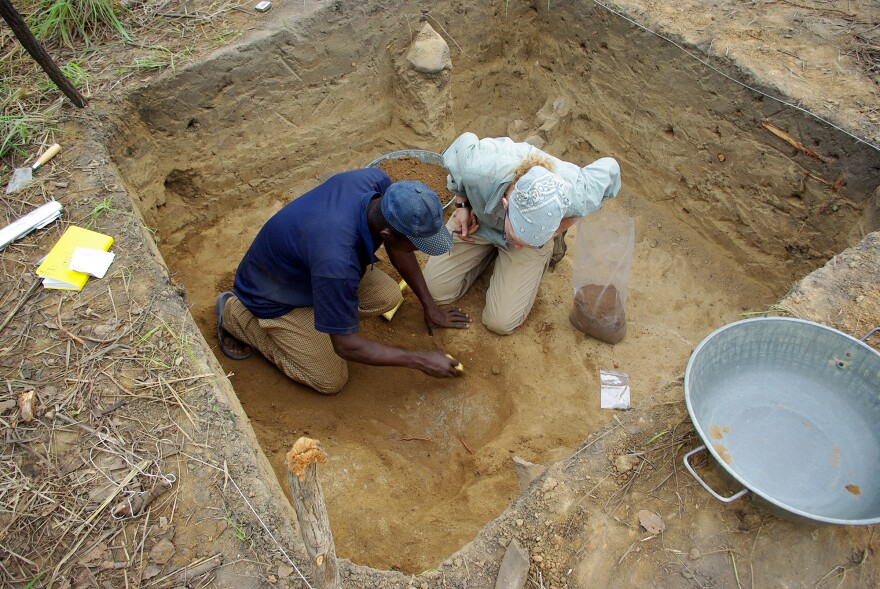 Grains, beads and bangles unearthed from dig sites in Banda, Ghana, tell of a time when droughts did not bring famine. (Above) Archaeologists Amanda Logan and Osei Kofi dig into the floor of a house from the 1500s.