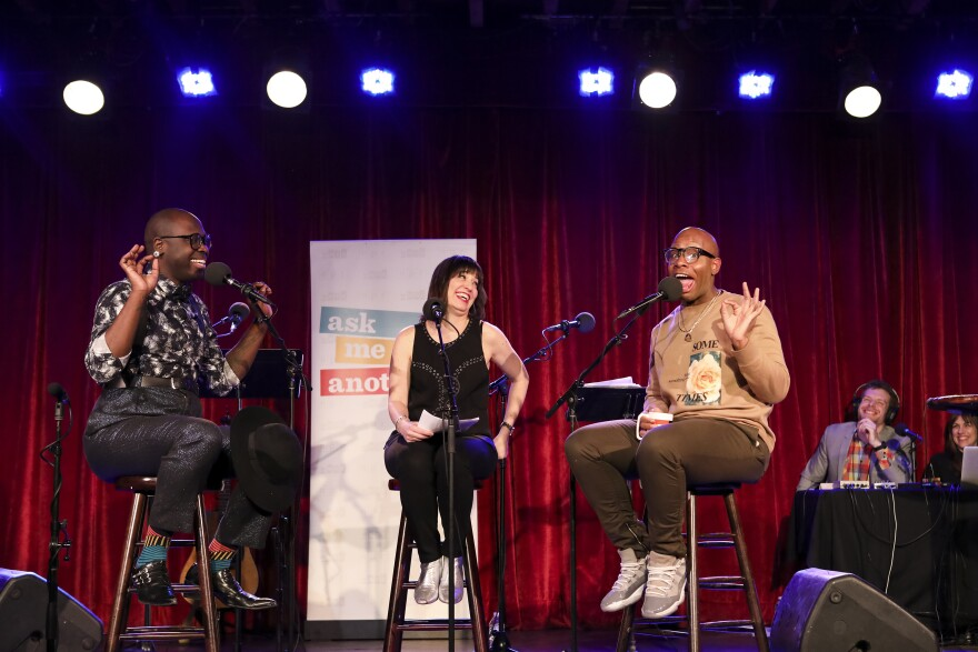 Host Ophira Eisenberg interviews Bob the Drag Queen and Monét X Change on <em>Ask Me Another</em> at the Bell House in Brooklyn, New York.