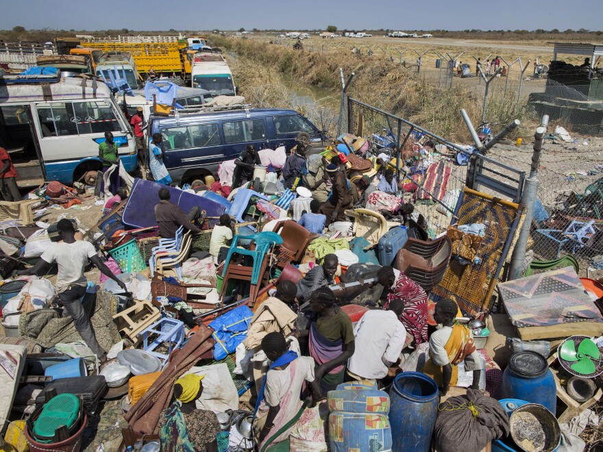 Civilians who fled the recent fighting stack their belongings up outside the gate of the United Nations Mission in South Sudan compound, in the provincial capital of Bentiu, west of Malakal, on Sunday.