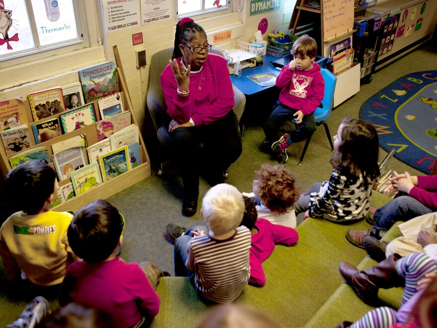 """Carolyn Barnhardt teaches her prekindergarten students a song about Rev. Martin Luther King Jr. She knows some might question how deeply 4- and 5-year-olds can comprehend this history, but she says, """"I think they understand."""""""
