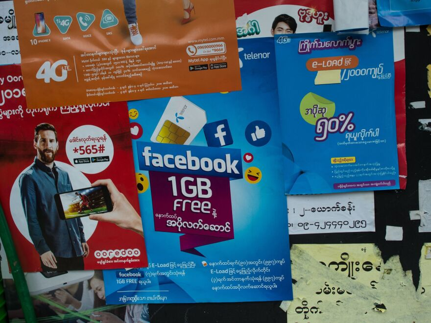 """The Facebook logo is seen on an advertisement by a local telecom company in Yangon. """"People think that Facebook is the Internet. It comes pre-installed on the phones that they buy,"""" says a Yangon-based digital activist. There are an estimated 27 million Facebook accounts in Myanmar."""