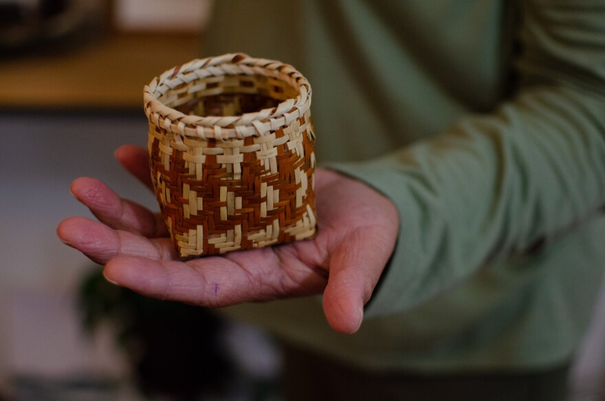 Betty Maney holds a small double weave river cane basket