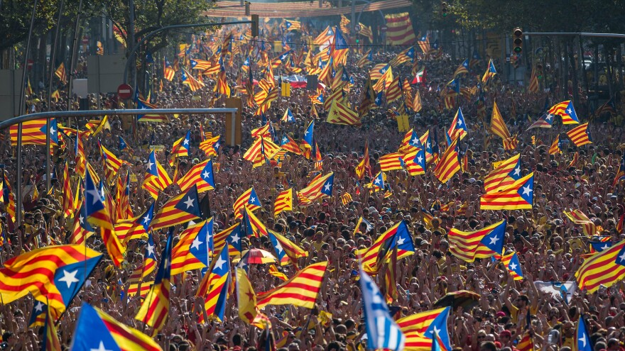 Demonstrators who support independence for Catalonia march in a Sept. 11 rally in Barcelona, Spain. Sunday's vote on independence is nonbinding.