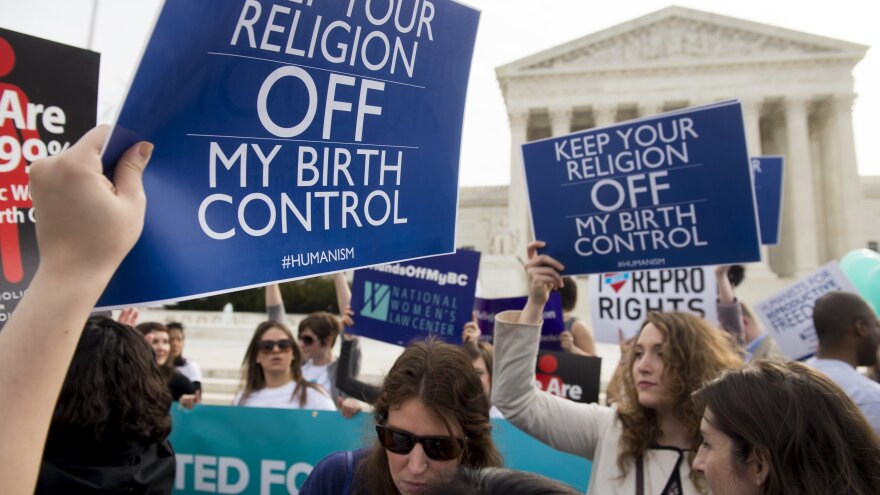 Supporters of women's health rally outside the Supreme Court in Washington, D.C., March 23, 2016, as the Court hears oral arguments in seven cases dealing with religious organizations that want to ban contraceptives from their health insurance policies on religious grounds.