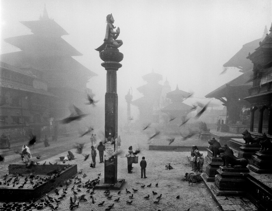Commemorating a king, the statue-on-a-pillar was erected in 1701 in Durbar Square in Patan, where a Krishna temple is located. The photo was taken in 1987. Much of the area sustained damage from the quake but the pillar is still standing.