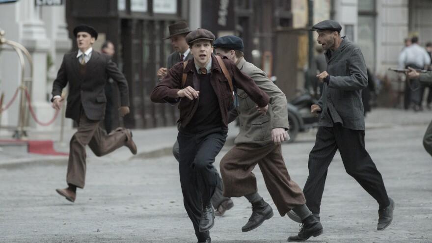 Marcel (Jesse Eisenberg) in the film <em>Resistance</em>.