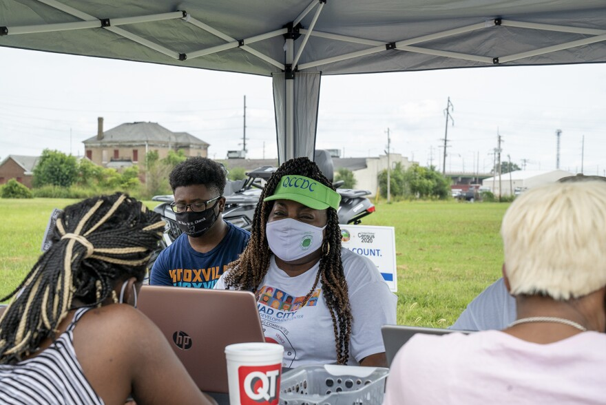 Yolanda Crochrell, center, helps a Granite City resident fill out her census form online in Venice, Ill. on Aug 29. This is one event where the Quad City Community Development Center is helping local Metro East residents fill out their census questionnaire.