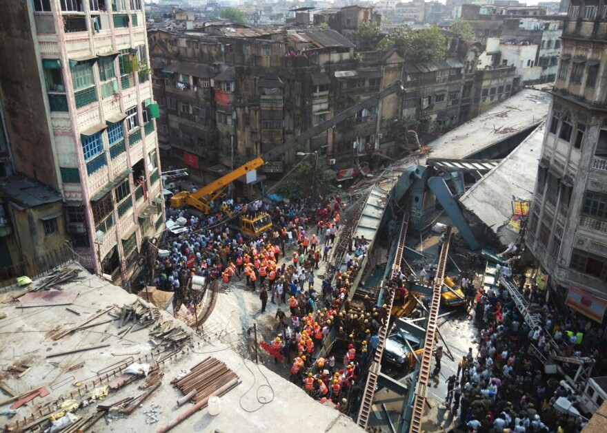 After an overpass partially collapsed in Kolkata, India, residents and rescue workers rushed to clear rubble and reach dozens of people who had been under the structure when its supports gave way.