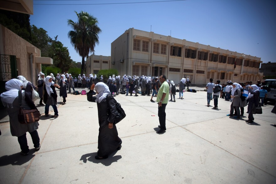 Schoolgirls outside the Martyrs of Libya school near Leptis Magna, Libya. The country's history books are being rewritten, and Gadhafi's rule is now described as a time of corruption and atrocities.