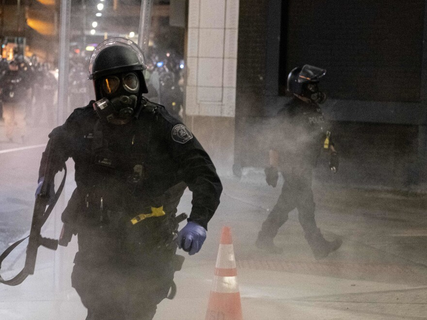 A Detroit Police officer uses tear-gas during a protest in the Detroit, on May 29, 2020.