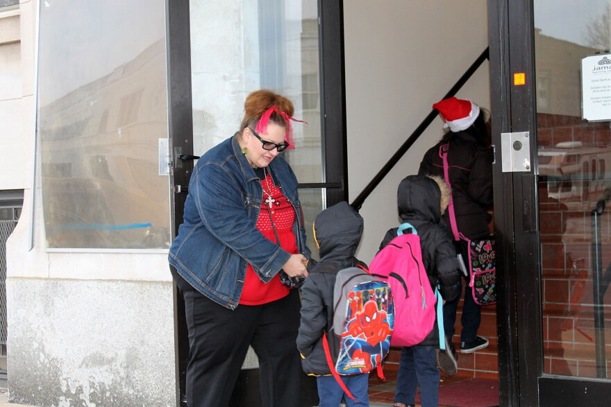 Special Education teacher Mary Tovar greets students entering Jamaa Learning Center on Thurs. Dec. 17, 2015.