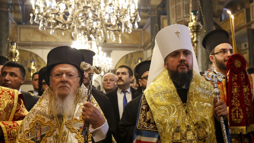 Ecumenical Patriarch of Constantinople Bartholomew I (left) and Metropolitan Epiphanius, the head of the new, independent Ukrainian Orthodox Church, attend the ceremony of signing the decree of independence for the Ukrainian church.