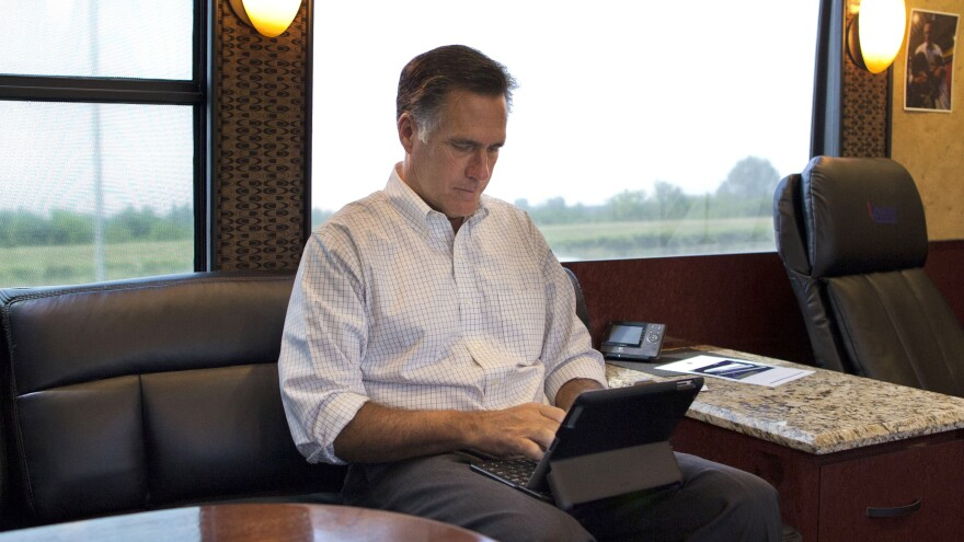 Mitt Romney, pictured riding on his campaign bus through Iowa during his 2012 presidential bid, has admitted to using a pseudonym on Twitter.