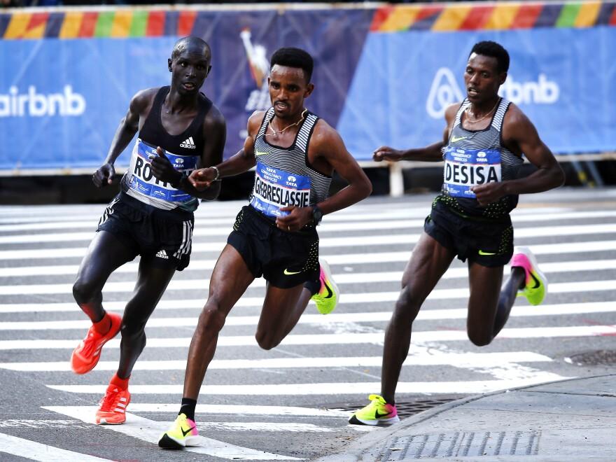 Ghirmay Ghebreslassie of Eritrea (center) Lucas Rotich of Kenya (left) and Lelisa Desisa of Ethiopia, during the New York City Marathon.