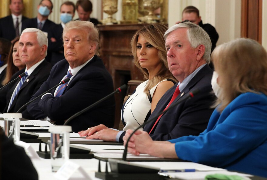 With Vice President Pence and first lady Melania Trump at his side, President Trump participates in a White House event Tuesday with students, teachers and administrators about how to reopen schools safely during the pandemic.
